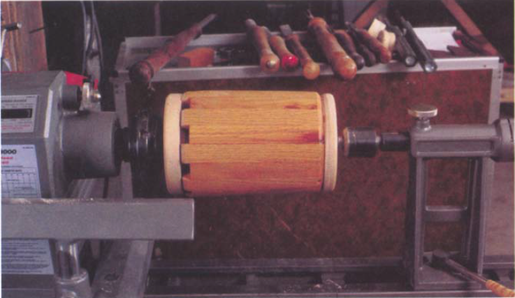 As in the case of this coopered birdhouse, the headstock mandrel can be left on the screw chuck.