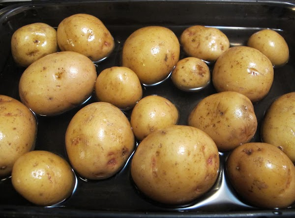 Preheat oven to 400 degrees.  Wash potatoes and place in an even layer...