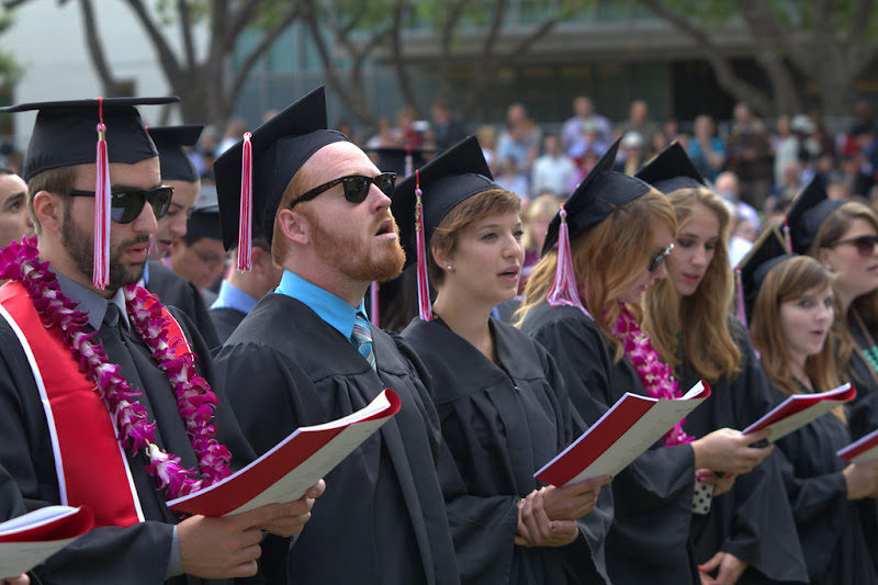 """Photo: Graduates sing the commencement hymn, """"Be Thou My Vision"""""""