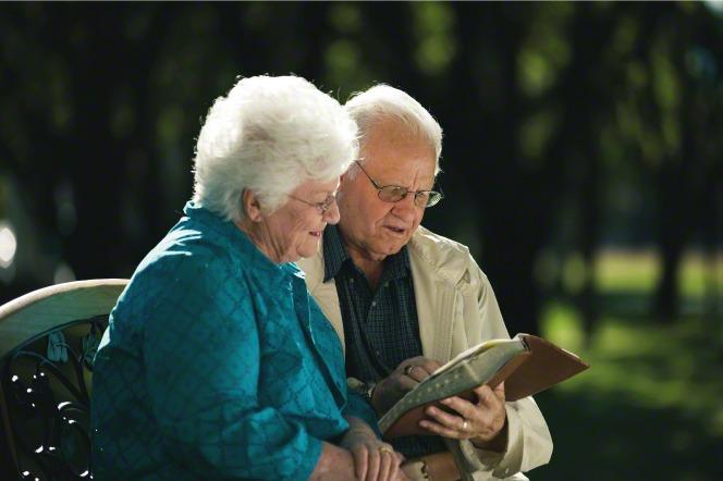 elderly mormon couple reading scriptures