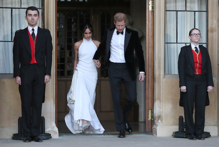 The newly married Duke and Duchess of Sussex, Meghan Markle and Prince Harry, leaving Windsor Castle after their wedding to attend an evening reception at Frogmore House, hosted by the Prince of Wales Windsor, Britain, May 19, 2018.