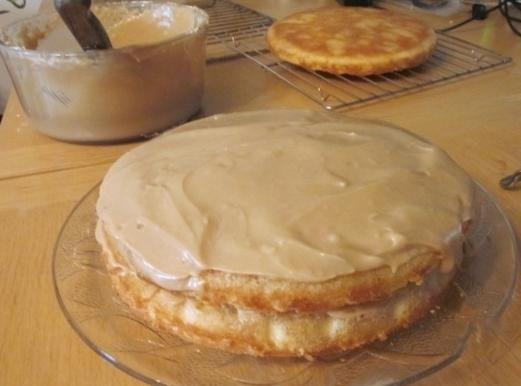 Spread with filling and do the same with the third layer of cake; top...