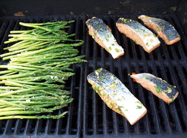 Place the salmon on the grill at a 10 o'clock angle presentation side down.