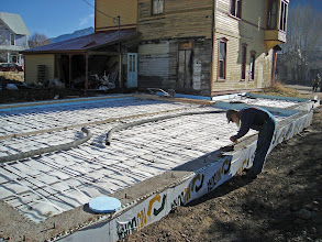 Photo: Back fill complete, foam insulation down, then rebar, and hydronic tubing tied off to the rebar. This will be a warm shop.
