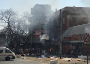 Some buildings in Pretoria were looted and set on fire on Wednesday morning.