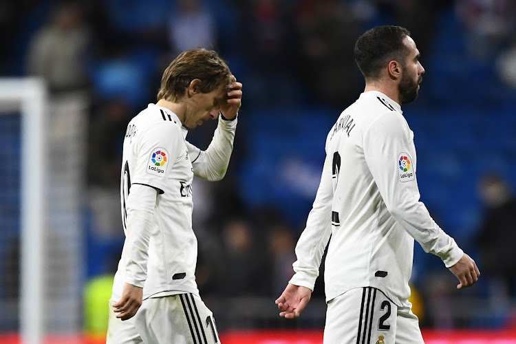 Real Madrid's Croatian midfielder Luka Modric (L) and Real Madrid's Spanish defender Dani Carvajal leave the pitch at the end of the Spanish League football match between Real Madrid CF and Real Sociedad at the Santiago Bernabeu stadium in Madrid on January 6, 2019.