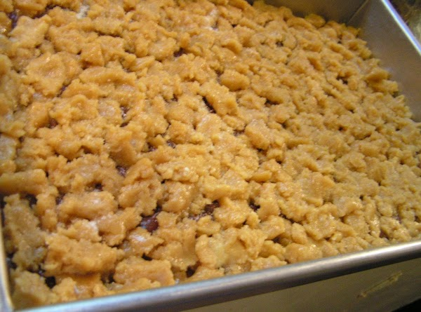 Crumble remaining batter over chocolate mixture. Sprinkle with sugar if desired.  Bake at...