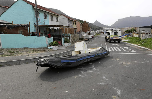 HIGH AND DRY: A dinghy ended up in the middle of the road after violent clashes.