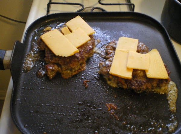 Top with cheddar and turn off heat.Use a piece of foil to create a...