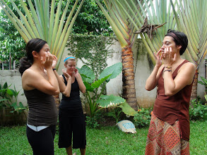 Photo: Yoga teacher trainees practicing Kapalarandradhauti (Face Massage) after Jalaneti Kriya.
