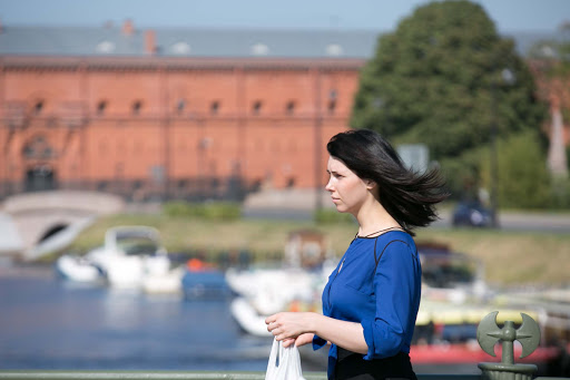 A local woman crosses the footbridge leading to Peter and Paul Fortress  in St. Petersburg, Russia.