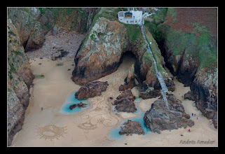 Photo: 'Emergence', Plemont Beach, Island of Jersey. Inspired by the cave and the narrow channel leading from the cave to the larger beach. I started way at the back of the cave where the sand started. In my mind the cave was breathing flames which turned into vines, then flowers off of which bud planets and stars. Done for the MyMemory.com World Beach Art Championships.