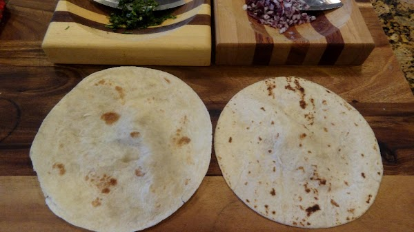 Place the two flour tortillas on the baking sheet. Set the rack at the...