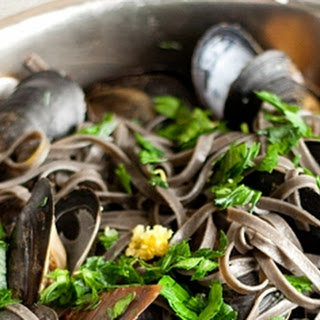 Garlicky Mussels with Squid Ink Linguine.