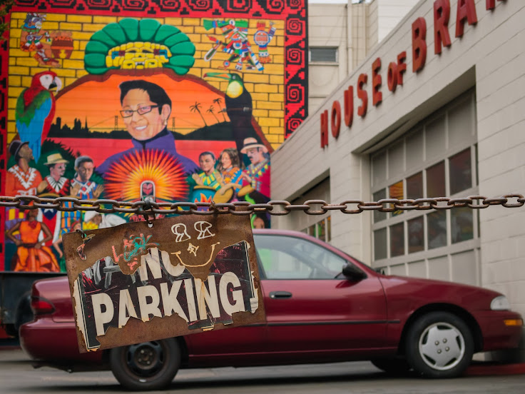 No Parking sign in front of House of Brakes - Carnival Mural
