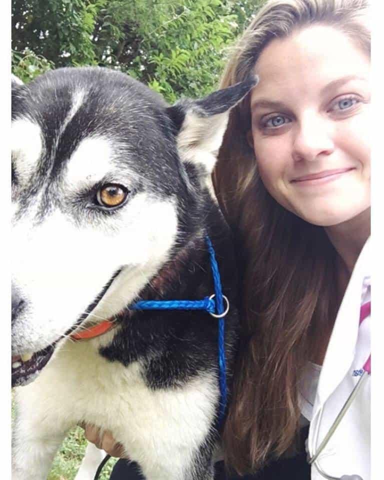 Kayla Mehan and a dog at LMU vet school