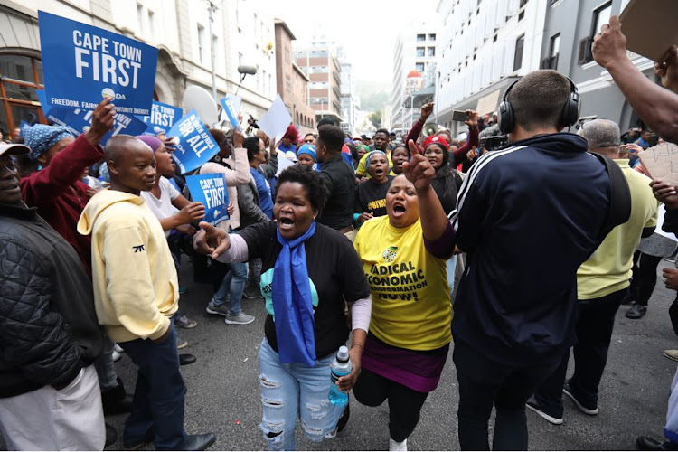 Protesters outside the Western Cape High Court as Patricia De Lille fights the Democratic Alliance's decision to rescind her party membership