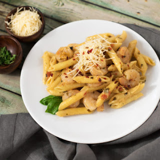 Spicy Shrimp with Penne Pasta and Herbed Cream Sauce.