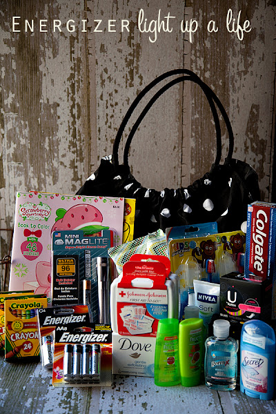 Photo: Join me as Em {my daughter} and I shop for the Energizer Light Up a Life Champion for kids Winter Survial Bag