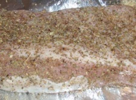 Rub herb mixture all over pork. Place in center of baking sheet and set...