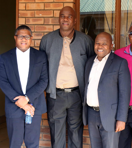 Chief Jeffrey Ramovha , c, police minister Fikile Mbalula, and Minister Des Van Rooyen during their visit at the Mulenzhe Traditional Authority Offices near Vuwani yesterday. PHOTO: ANTONIO MUCHAVE