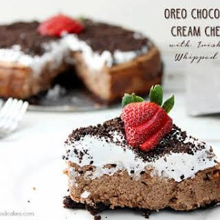 Oreo Chocolate Irish Cream Cheesecake with Irish Cream Whipped Cream.