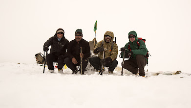 Photo: Jamie McGuinness, Lobsang, Olivier Dubuis and Garry Deering on the summit of Lungser Kangri, ~6666m - congratulations! Shame about the cloud though. We did get occasional views, and on the way down though. This is perhaps our only photo the dog isn't in.