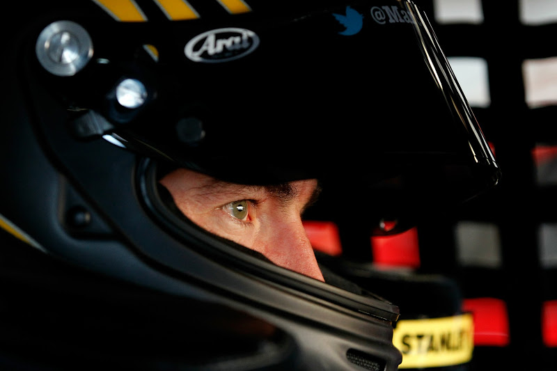 Photo: SONOMA, CA - JUNE 23:  Marcos Ambrose, driver of the #9 Stanley Ford, sits in his car in the garage during practice for the NASCAR Sprint Cup Series Toyota/Save Mart 350 at Sonoma on June 23, 2012 in Sonoma, California.  (Photo by Tom Pennington/Getty Images)