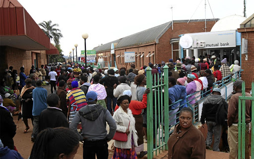 VBS Mutual Bank customers form long queues outside the bank in Thohoyandou, Venda, yesterday to withdraw their monies.