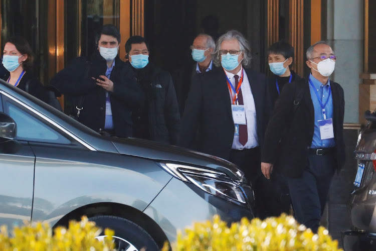 Members of the World Health Organisation (WHO) team tasked with investigating the origins of the coronavirus disease (Covid-19) prepare to leave a hotel in Wuhan, Hubei province, China January 29, 2021.