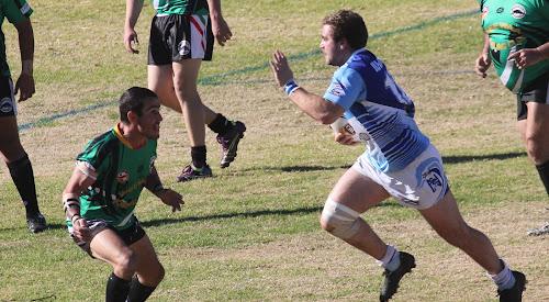 Narrabri's Daniel Howe runs at Wee Waa's Scott Spencer on Sunday at Collins Park.