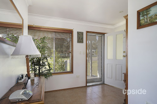 Photo of property at 32 Cams Boulevard, Summerland Point 2259