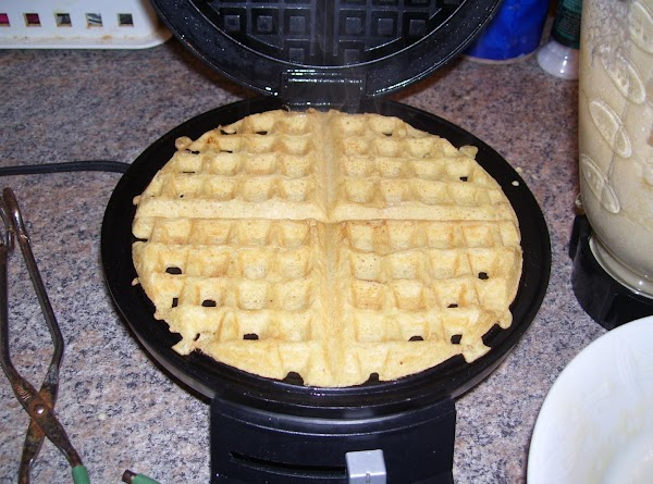 Meanwhile, when the waffle iron is hot, cook the waffles following the directions for...