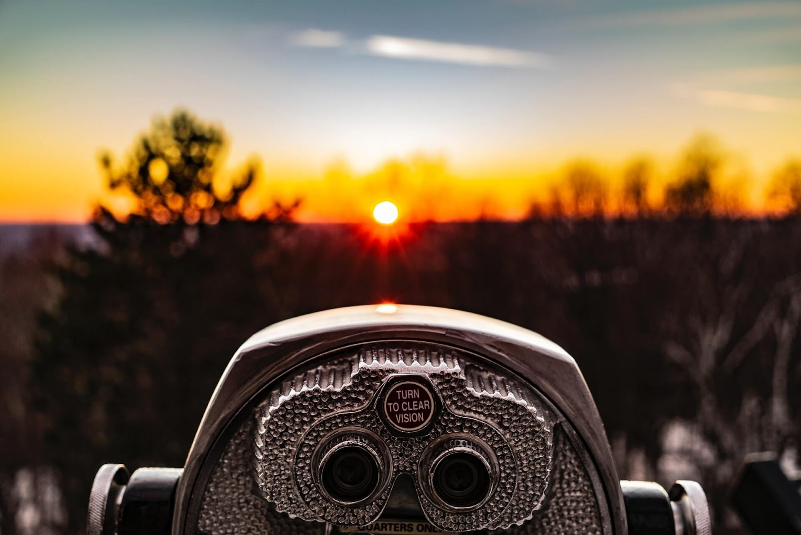 Telescope pointing at a sunset