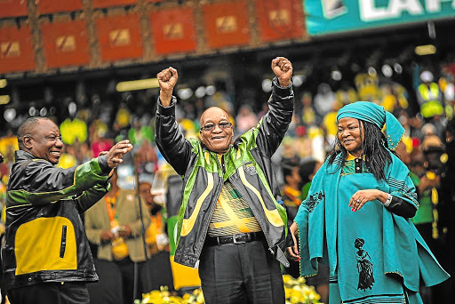 President Jacob Zuma raises his fists as he is welcomed by Deputy President Cyril Ramaphosa and national executive committee chairwoman Baleka Mbete at the ANC's 105th birthday rally at Orlando Stadium in Soweto. Picture: SOWETAN