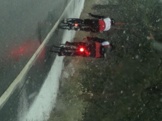 John Johnson and Bill Cappobianco on Onyx Summit riding bikes in snow storm near Onyx Summit near Big Bear