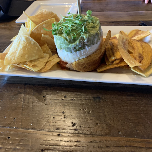 Three layer dip with house made tortilla chips and house made plantain chips.  Absolutely stunning presentation and even more delicious !!!