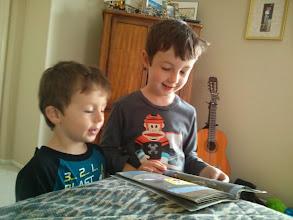 Photo: Clark Reads a Whole Book to Finn