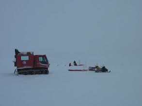 Photo: The Piston Bully, snow machines and crews working