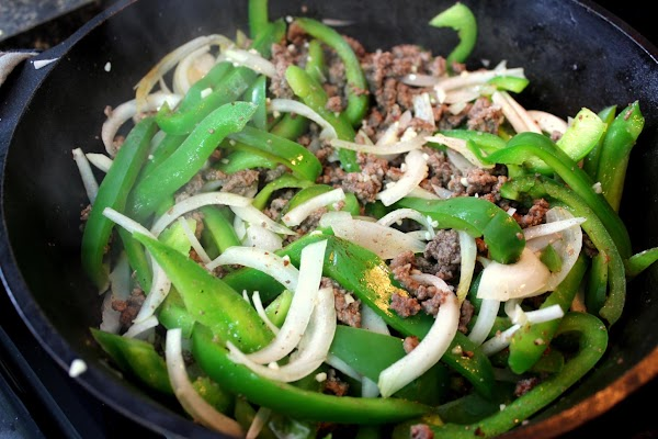 Add onion, peppers and garlic to ground beef and cook until onion is just...
