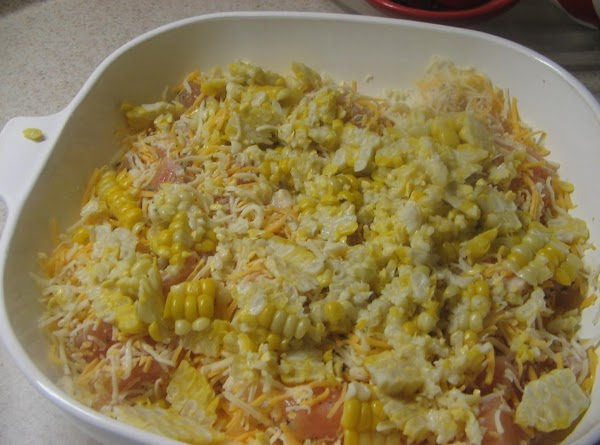 In another bowl combine raw chicken pieces, basil, corn and cheese, mix well. Add chicken...