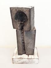 Photo: SKEWED --- 11 X 5 1/4 X 3 5/8 cast aluminum, ipe base