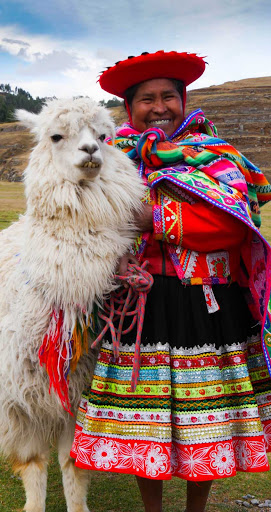 Ponant-Peru-woman-llama.jpg - Cruise to Peru on Ponant's Le Boreal and get immersed in local culture.
