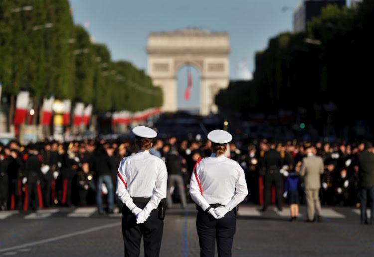 French police stand guard prior to the start of the traditional Bastille day military parade on the Champs-Elysees in Paris, France, July 14, 2017.