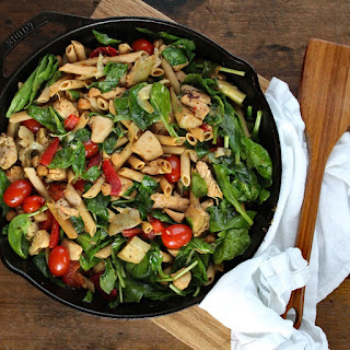 Herbed Chicken and Pasta Skillet with Blistered Tomatoes, Artichokes, and Spinach.