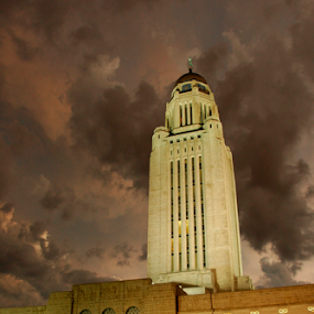 Nebraska State Capitol by Gayle Mittan - Buildings & Architecture Public & Historical ( lightning, storm, historic, dusk, night, nebraska, clouds, building, stone, capitol, state capitol, night light, weather, state, landmark, evening,  )