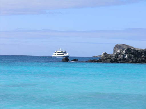 An expedition ship moored in the Galápagos.
