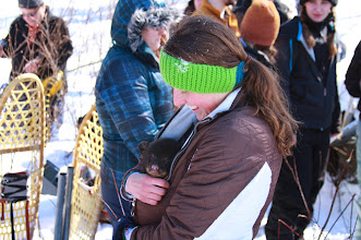 Photo: UWSP College of Natural Resources student keeps a black bear cub warm