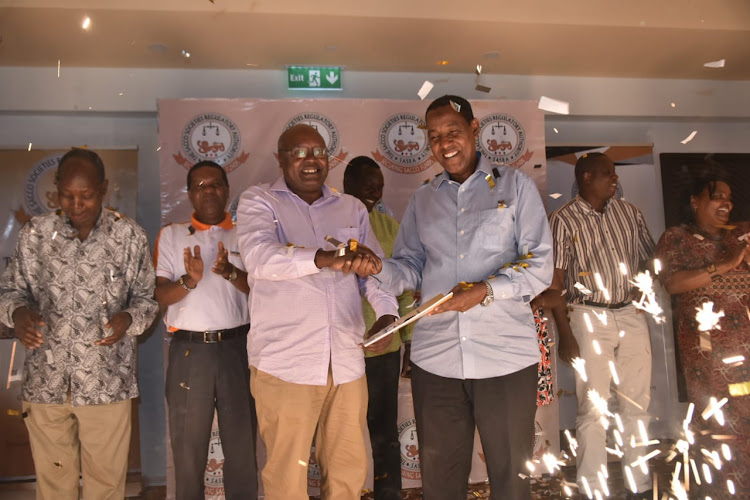 Sasra chair John Munuve and Cooperatives PS Ali Noor during the launch of a Sacco sub-sector report/FILE