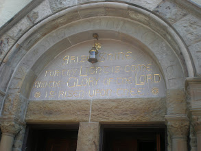 Photo: engraving of biblical scripture above the chapel doors. DuBois had it inlaid in gold as a gift